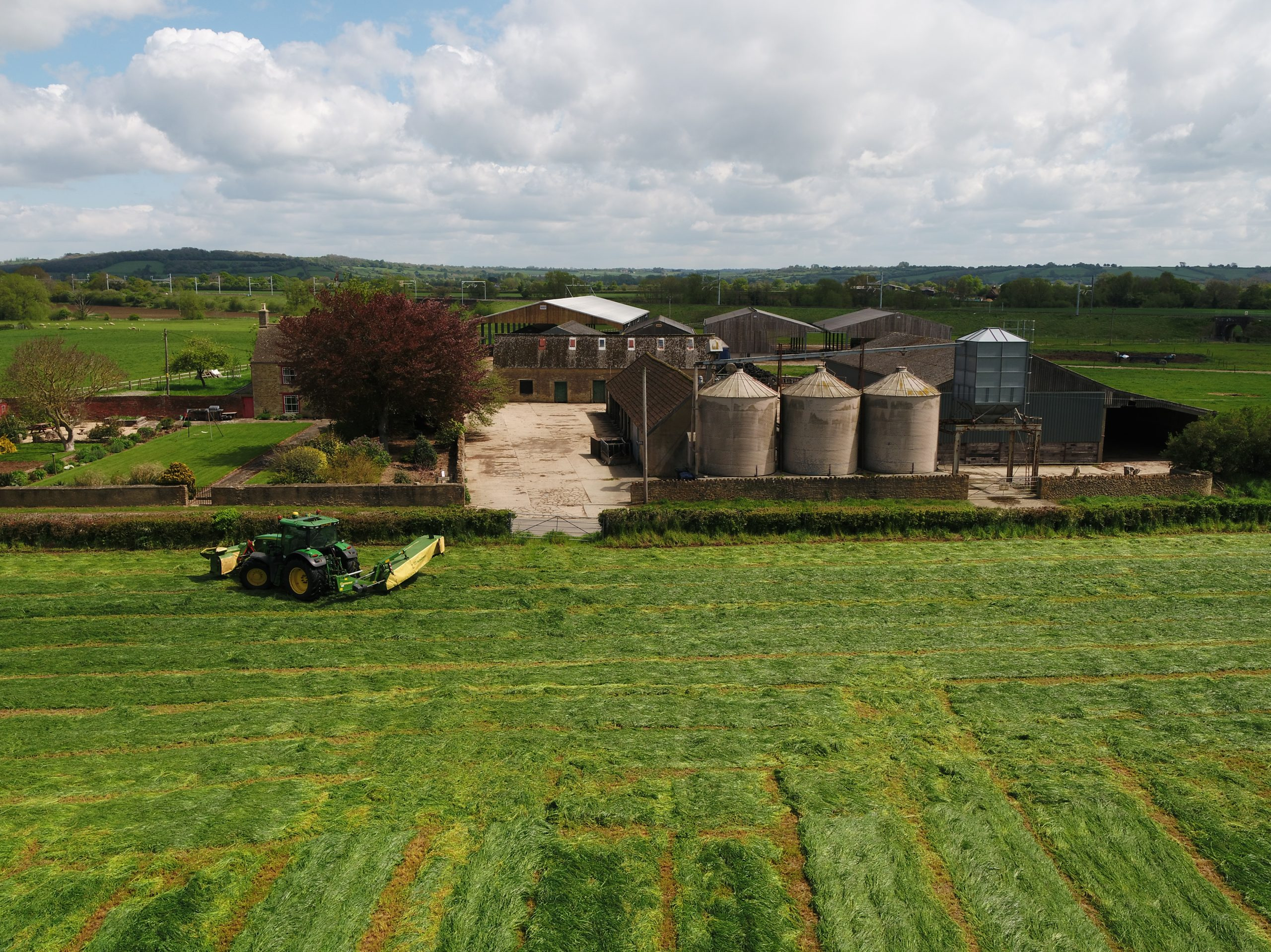 image of tractor in field taken by drone