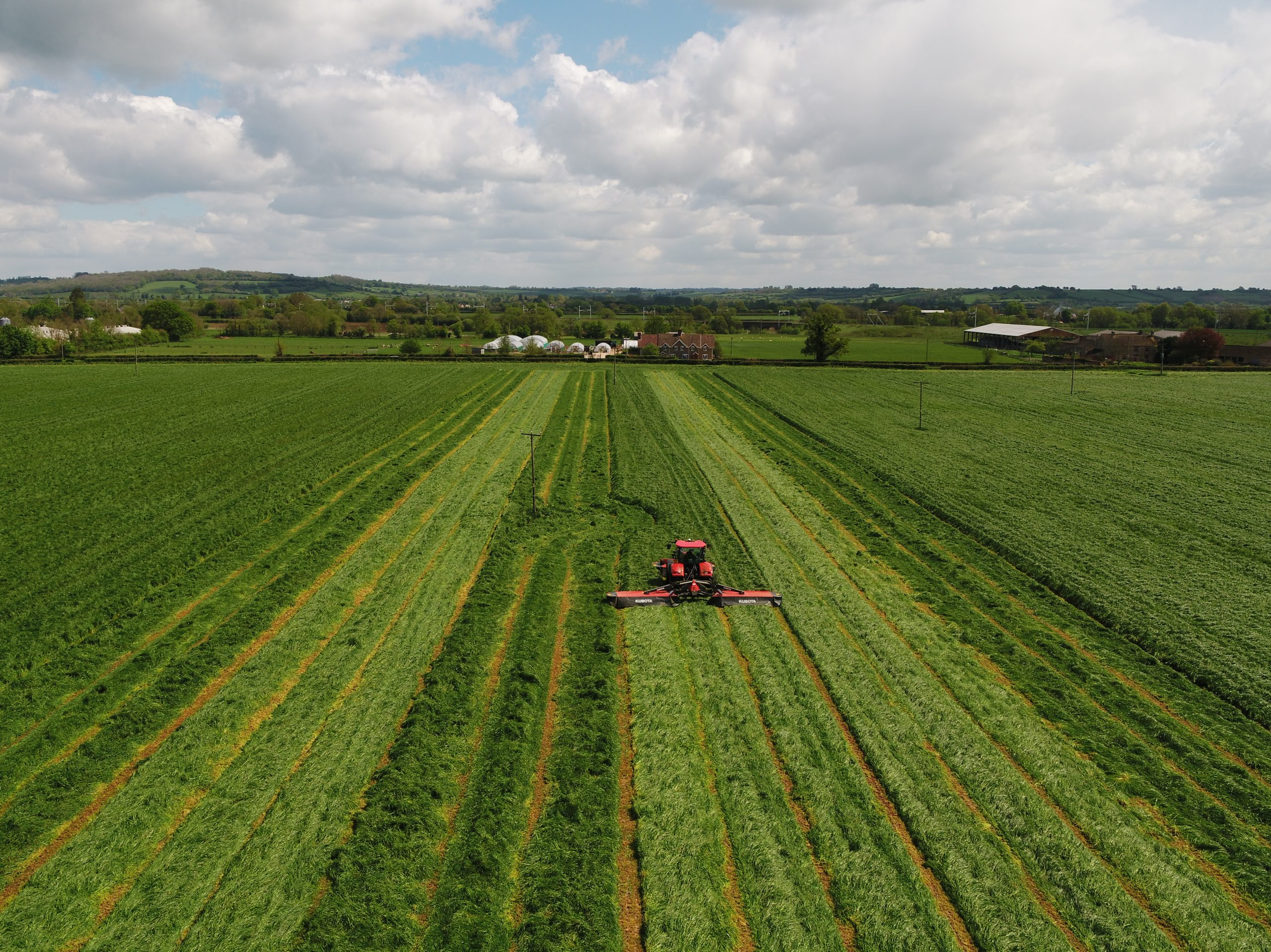 drone image of tractor and field